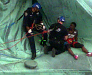 Police take down protester Therese Okoumou at the Statue of Liberty