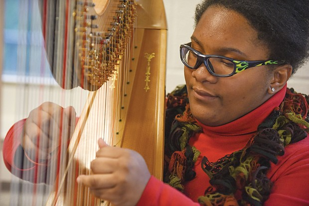 IT'S ALL IN THE WRIST-  Mariesha Little rehearses with the HARPS Foundation – American Youth Harp Ensemble, which develops and offers programs and performances for children and youth in the greater Richmond area. HARPS also seeks to increase the appreciation, performance and therapeutic value of the harp in the U.S. and throughout the world.