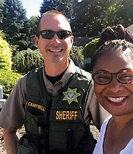 State Rep. Janelle Bynum and the selfie photo she took with a Clackamas County deputy who responded to a 911 call when one of her constituents reported suspicious activity as she was canvassing for votes in a Clackamas neighborhood last week.
