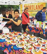 A community cooking class at the King Portland Farmers Market at King School Park in northeast Portland has folks learning how to make fresh salsas and tortillas with Hot Mama Salsa.