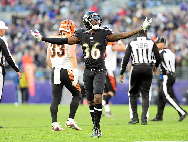 Baltimore Ravens cornerback Tavon Young celebrates after breaking up a pass in a game against the Cincinnati Bengals during the 2016 NFL season.