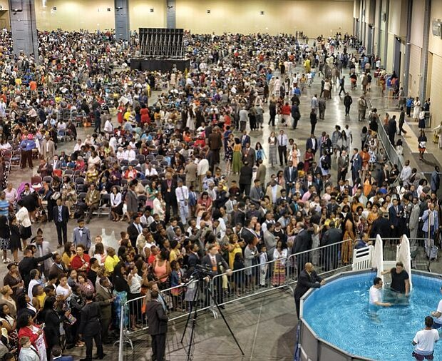 "Followers pool together for convention-Thousands of Jehovah's Witnesses gather at the Greater Richmond Convention Center in Downtown for last weekend's convention. Religious followers from Virginia, North Carolina, Maryland, Washington and Delaware have been attending the series of three-day conventions in Richmond that will run each weekend through Aug. 5. The theme: ""Be Courageous!"""
