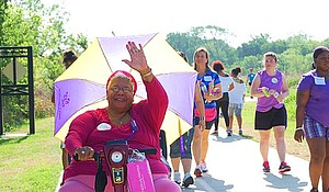 Local individuals with lupus, family members and other support groups participate in a lupus awareness walk.
