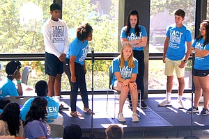 TeenAge Communication Theatre group performs a skit on domestic violence.