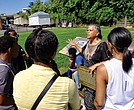 Ana Edwards, chair of the Sacred Ground Historical Reclamation Project, leads a tour in July 2016 of the African Burial Ground and Lumpkin's Jail site in Shockoe Bottom. Her audience is composed of young people taking part in a summer leadership program sponsored by the Maggie Walker National Historic Site.