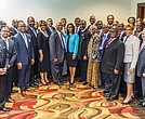 AME Church bishops pose with black bankers and business leaders after the June 26 announcement of the historic partnership.