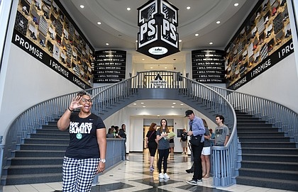 "Principal Brandi Davis waves in the lobby of the I Promise School. ""We are going to be that groundbreaking school that will be a nationally recognized model for urban and public school excellence,"" she said. (Wally Skalij / Los Angeles Times)"
