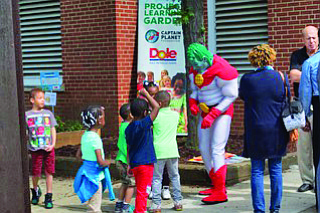 Captain Planet was ton hand to celebrate with the students.