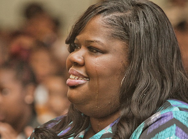 Kiwana Yates, the ousted principal of Carver Elementary School, sheds a tear during a March 2015 school assembly for winning a R.E.B. Award for Distinguished Educational Leadership. The award, given in partnership with The Community Foundation, came with a $15,000 prize. Half was for her personal use. The other half, she said at the time, would be used for educational field trips.