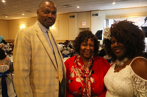 (Left to right) City Council Terry Morris, Deborah Cole and Tracy Theard enjoying the evening at the annual Joliet NAACP Freedom Fund Banquet.