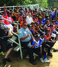 Members of the Chicago Police Department recently acted as coaches for young baseball players, from Austin, Englewood, and North Lawndale neighborhoods, as they faced-off in Get IN Chicago's Police/Youth Baseball League All-Star game. Photo Credit: Get IN Chicago