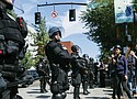 Portland police keep Patriot Prayer affiliates separate from antifa protesters during a rally in Portland, Saturday. (AP photo)