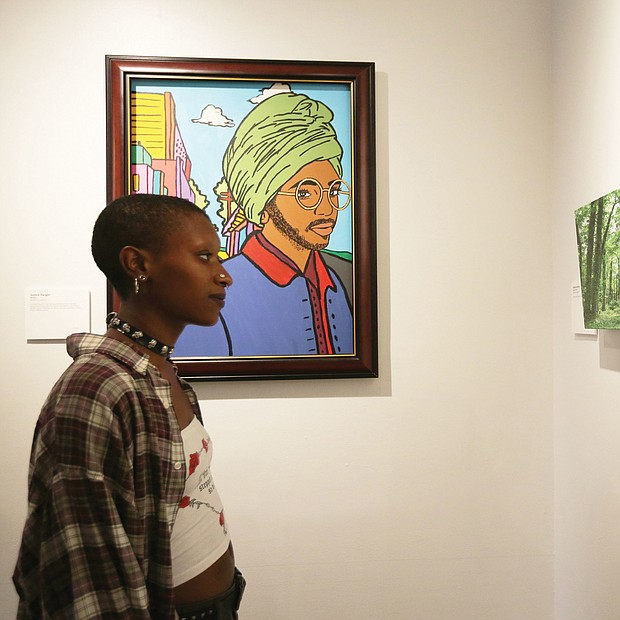 "Cree takes in the artwork that she and 19 other program leaders at ART180 created to celebrate the nonprofit's 20th year of giving young people from challenging circumstances an opportunity to express themselves through painting, sculpture, murals and other art. The anniversary exhibit opened last Friday at the organization's Atlas Galley, 114 W. Marshall St. Work from the exhibit, titled ""Twenty: ART 180 Takes the Bus,"" will spend most of August touring the city on GRTC buses."