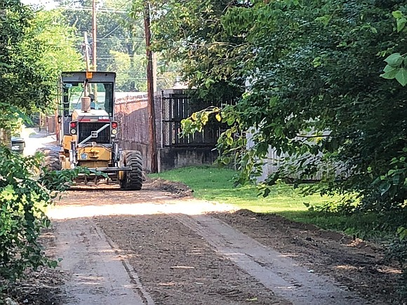 The roar of heavy equipment over a backyard fence signals the start of work on another alley. Suddenly, with little ...
