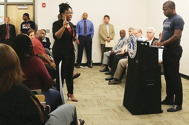 Princess Blanding, the sister of shooting victim Marcus-David Peters, confronts Mayor Levar M. Stoney at a July 26 community meeting about the death of her brother, who was shot by a Richmond Police officer on May 16.