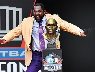 Former Baltimore Ravens linebacker Ray Lewis dances with joy beside his bust during his speech at the Pro Football Hall of Fame induction ceremony last Saturday in Canton, Ohio.