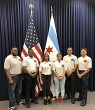 Student of the Black Fire Bridage are pictured in uniform during a visit to City Hall