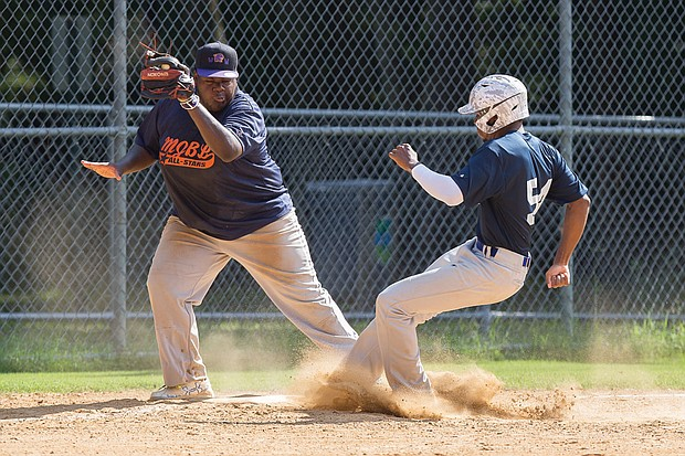 Mitch Jackson, right, narrowly misses being tagged out by Deyshaun Miles as he comes into third base during the Metropolitan Junior Baseball League All-Star Game last Saturday.