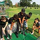 Young people learn the game of golf as part of Portland Parks and Recreation's efforts to connect Portlanders of all ages and backgrounds with the game. To mark 100 years of public golf courses in the city, a free celebration will take place Sunday at the Colwood Golf Center in northeast Portland.