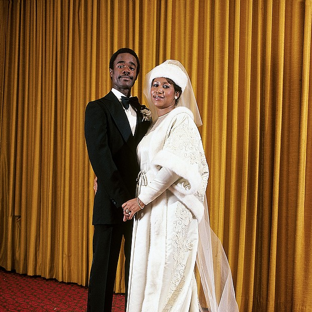 Aretha Franklin is photographed with her new husband, Glynn Turman, at their wedding in April of 1978.