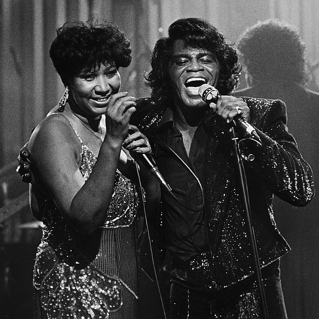 "The ""Queen of Soul"" performs with the ""Godfather of Soul,"" James Brown, at Detroit's Taboo nightclub in January 1987. The show was taped for airing on HBO."