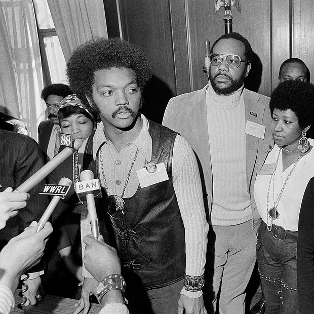 Ms. Franklin, second from right, stands with the Rev. Jesse Jackson Sr. as he speaks with reporters at the Operation PUSH Soul Picnic in March 1972 at the 142nd Street Armory in New York City. With them are, from left, Betty Shabazz, widow of Malcolm X; PUSH Vice President Tom Todd; South African singer Miriam Makeba; and Congressman Louis Stokes of Ohio.