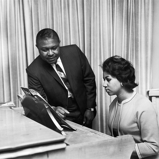 Aretha Franklin receives music advice from her father, the Rev. C.L. Franklin, in this undated photo.