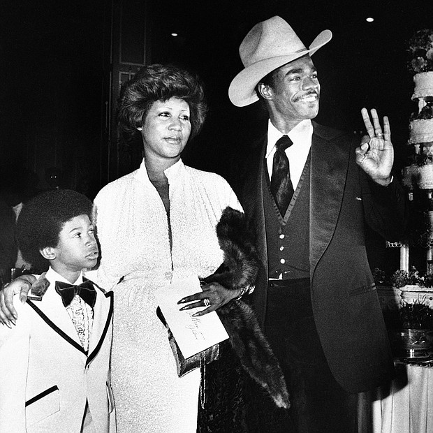 Ms. Franklin arrives at her Los Angeles hotel wedding reception with her new husband, actor Glynn Turman, and her 8-year-old son, Kecalf, on April 17, 1978.