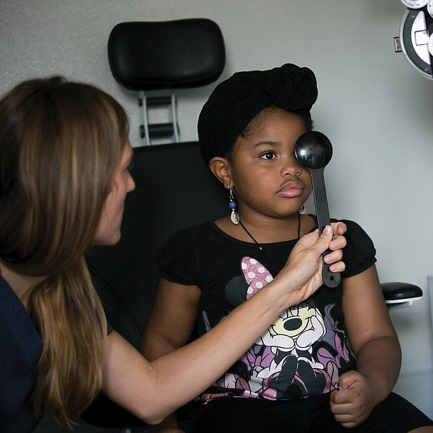 Health checks Malaysia Hubbard, 5, has her vision checked by an optometrist during last Friday's free back-to-school physicals and health checks by the state's Richmond Health District Office. The annual event, conducted in partnership with the Virginia Commonwealth University School of Nursing, provided the necessary checks for youngsters for Head Start and school entry.