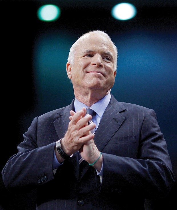 U.S. Sen. John McCain listens as he's introduced at an October 2008 campaign rally in Fayetteville, N.C., during his run for president against then-Sen. Barack Obama.