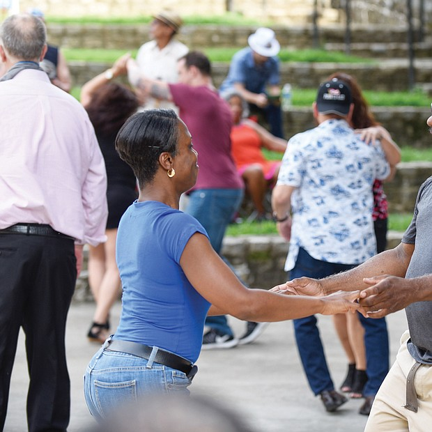 """Flavor of dance The stage at Dogwood Dell amphitheater in Byrd Park turned into a dance floor last Saturday for couples to show off their best moves at the 11th Annual Latin Jazz and Salsa Festival. Hosted by the nonprofit Latin Jazz and Salsa Show/Festival Inc., the event featured a bevy of performers who made spectators want to get up and dance. Sukenya Best and Willie """"Mac"""" McDonald get into the flavor of the dance."""