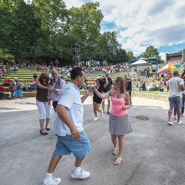 Flavor of dance The stage at Dogwood Dell amphitheater in Byrd Park turned into a dance floor last Saturday for couples to show off their best moves at the 11th Annual Latin Jazz and Salsa Festival. Hosted by the nonprofit Latin Jazz and Salsa Show/Festival Inc., the event featured a bevy of performers who made spectators want to get up and dance.