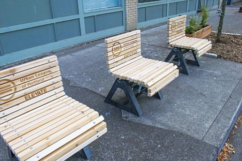 Artful rocking benches designed in collaboration with community youth of color and graduate art students line North Russell Street next at the Urban League of Portland headquarters.