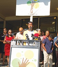 Kali Thorne-Ladd, executive director and co-founder of KairosPDX, a public charter school working to close the achievement gap for black children, leads a press conference with supporters and students last week calling on Portland Public Schools to give the school stability by extending the district's one year lease of the former Humboldt school site to five years.