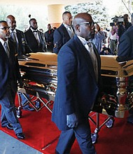 Pallbearers carry the gold casket of legendary singer Aretha Franklin on Friday after arriving for her funeral at the Greater Grace Temple in Detroit. Franklin died Aug. 16 of pancreatic cancer at the age of 76.