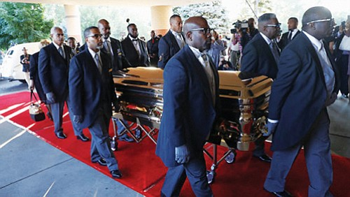 (AP) -- An all-star lineup of mourners filled a Detroit church with prayers and songs Friday for Aretha Franklin's funeral, ...