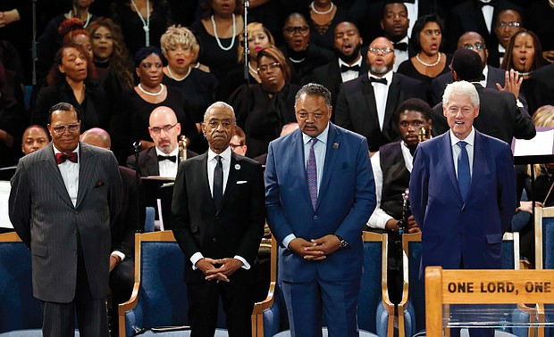 Together in the pulpit at Greater Grace Temple during the service are, from left, Minister Louis Farrakhan of the Nation of Islam; the Rev. Al Sharpton of the National Action Network; the Rev. Jesse L. Jackson Sr. of the National PUSH Rainbow Coalition; and former President Bill Clinton.