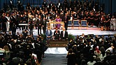 Together in the pulpit at Greater Grace Temple during the service are, from left, Minister Louis Farrakhan of the Nation of Islam; the Rev. Al Sharpton of the National Action Network; the Rev. Jesse L. Jackson Sr. of the National PUSH Rainbow Coalition; and former President Bill Clinton. Mourners at the packed Greater Grace Temple in Detroit rise near the end of the eight-hour service for Ms. Franklin.