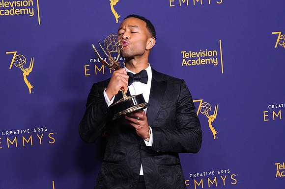 John Legend made history twice over the weekend. The singer-actor won an Emmy at the Creative Arts Emmy Awards on ...