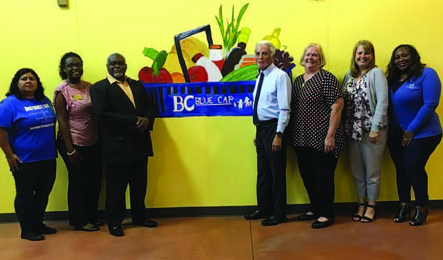A grand opening ceremony was recently held for the Blue Cap Food Pantry located on 2155 Broadway St. in Blue Island. The Food Pantry is partnering with the Greater Chicago Food Depository and will be mostly operated by people with intellectual disabilities. Photo Credit: Provided by Blue Cap