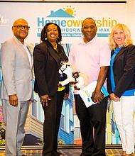 Frederick Seaton (in center) of the South Side was the first recipient of a $15,000 down payment assistant grant on August 24 during the NeighborhoodLIFT event at McCormick Place.  The NeighborhoodLIFT program is a collaborative effort between Wells Fargo, Neighborhood Works and Neighborhood Housing Services of Chicago.