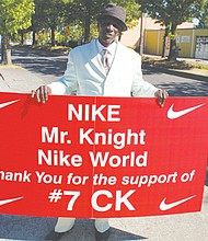 Portland native Lawrence Jefferson displays his billboard supporting Nike for picking former NFL quarterback Colin Kaepernick as the face of its 30th anniversary  'Just do It' advertising campaign.