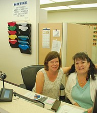 Lisa DiTommaso (left) and Tanya Murdock welcome patients to the Russell Street Dental Clinic which serves the low-income community by charging fees on a sliding scale. The clinic recently hired a new full time dentist and upgraded facilities to serve more people. An open house will be held this Saturday afternoon to celebrate.