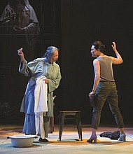 "Mother Cai (Natsuko Ohama, left) and Tianyun (Amy Kim Waschke) share some harsh truths about their pasts in the Oregon Shakespeare Festival's current production of 'Snow in Midsummer,"" a classic Chinese drama about a young woman who is wrongly executed for a crime she didn't commit."