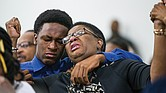 Allison Jean leans on her son, Brandt, during a prayer service last Sunday at Dallas West Church of Christ for her 26-year-old son, Botham Jean, above, who was shot and killed in his apartment Sept. 6 by Dallas Police Officer Amber Guyger.