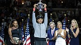 Naomi Osaka, 20, of Japan holds the single's title trophy after defeating Serena Williams last Saturday in a game that will long be remembered.