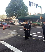 Police stand outside the Cheerful Tortoise bar following the June 29 shooting of a Jason Washington, a 45 year-old black Navy veteran  and postal worker who was shot and killed by Portland State University police while trying to stop a bar fight across from the campus.