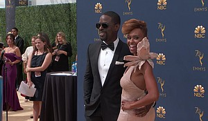 Sterling K. Brown and his wife, Ryan Michelle Bathe, appear on the red carpet for the 70th Primetime Emmy Awards.