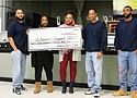 Ayasha Shamsud-Din and Talunaka Washington (center) of the Portland African American Leadership Forum (PAALF) visit the Oregon State Penitentiary to accept a 2017 donation of $2,500 to purchase coats for children in foster care. The donation was raised by inmates of Uhura Sasa, an African American culture club at the prison. A new campaign to raise donations for coats for children is now underway.