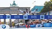 After sprinting through the Brandenburg Gate, Eliud Kipchoge crosses the finish line to break the tape and a world record Sunday at the Berlin Marathon. He is the first person ever to finish a 26.6-mile marathon in less than 2 hours and 2 minutes.